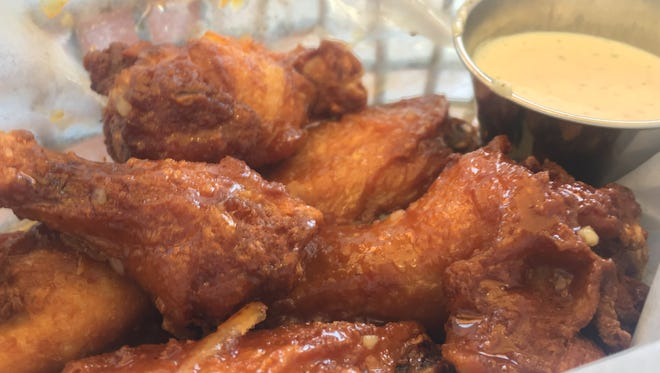 A plate of traditional chicken wings at Choice City Wings.
