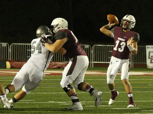 Don Bosco QB Tommy DeVito passes the ball during first half.