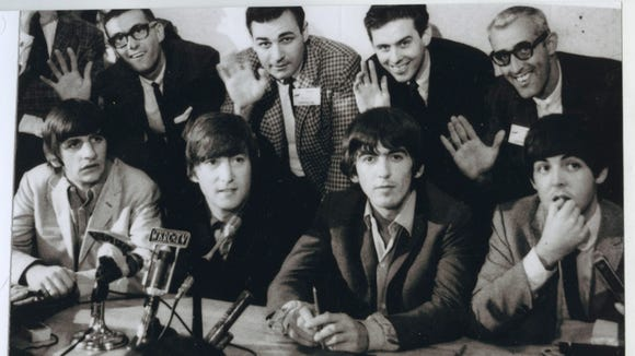 WSAI-DJ Steve Kirk (back right) waves to Walter Burton's camera with fellow DJs at the Beatles' 1964 press conference.