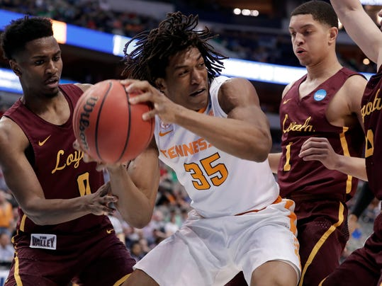 Tennessee forward Yves Pons (35) works beneath the basket for a shot attempt as Loyola-Chicago's Donte Ingram (0), Lucas Williamson (1) and Ben Richardson, right, defend during the first half of a second-round game at the NCAA men's college basketball tournament in Dallas, Saturday, March 17, 2018. (AP Photo/Tony Gutierrez)