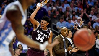 Texas A&M Aggies center Tyler Davis (34) reacts on the bench during the second half against the North Carolina Tar Heels in the second round of the 2018 NCAA Tournament at Spectrum Center.