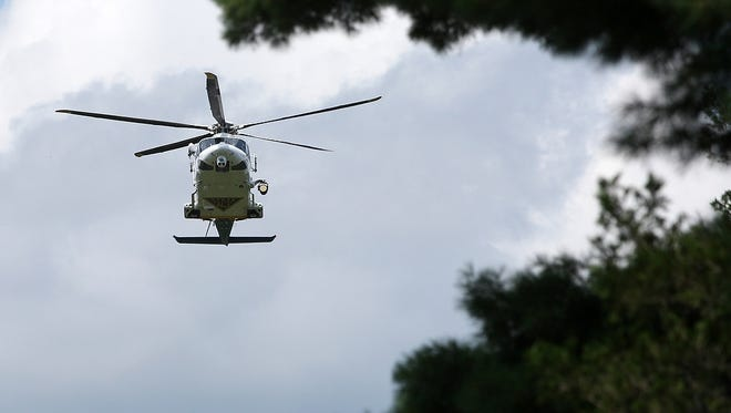 A NJ State Police helicopter flies over the funeral service for Hinal K. Patel of Piscataway, Monday, July 27, 2015, at the Franklin Memorial Park in North Brunswick, NJ.  Patel, age 22, was killed when her Spotswood ambulance was involved in a motor vehicle accident in East Brunswick.
