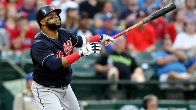 The Indians' Carlos Santana hits a leadoff home run against the Rangers at Globe Life Park in Arlington.