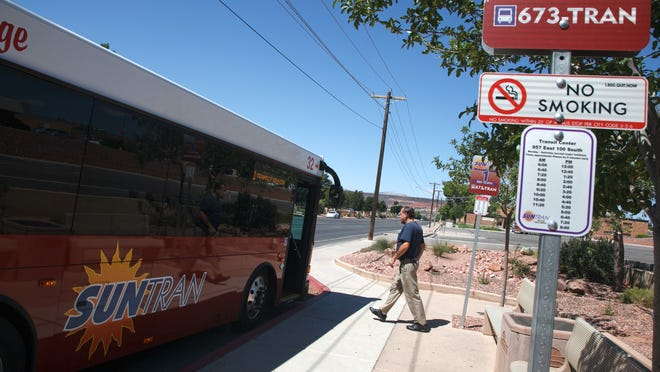 A passenger boards a SunTran bus at the transit center bus stopon 100 South and 1000 East in St. George, Monday.