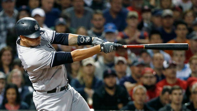 New York Yankees' Gary Sanchez follows through on a two-run double during the fifth inning of a baseball game against the Boston Red Sox in Boston, Friday, Sept. 16, 2016.