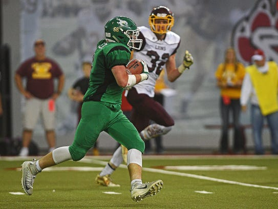 Colome's Jackson Kinzer (6) carries the ball after