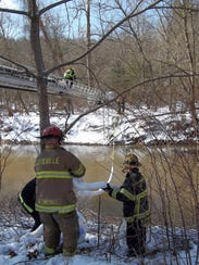 Asheville Fire Department firefighters deploy an oil-absorbent