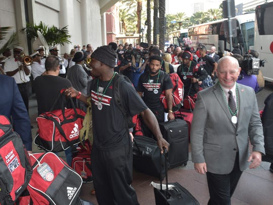 Louisiana Ragin Cajuns football team arrives in New Orleans Tuesday at the Marriot Hotel.