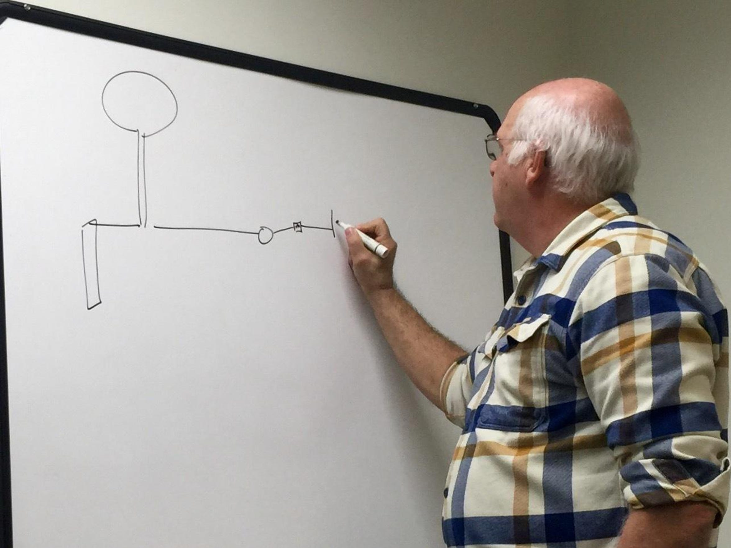 Ken Fanfoni, executive director of Augusta County Service Authority, uses a whiteboard to draw out part of the county's water infrastructure.