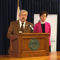 Gov. Terry Branstad takes questions from reporters on Monday at the Iowa Capitol. On his right is Lt. Gov. Kim Reynolds.