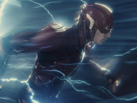 "This image released by Warner Bros. Pictures shows Ezra Miller in a scene from ""Justice League,"" in theaters on Friday. (Warner Bros. Entertainment Inc. via AP)"