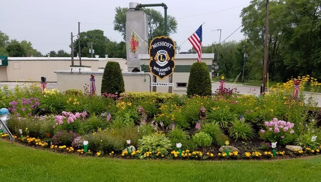The Mishicot Lions Club - which sponsors the flower bed on Main Street, seen here - will host a downtown fry out on Aug. 13.