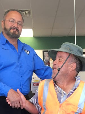 Lino Chavez, retired newspaper street vendor, shakes the hand of Richard Holguin, manager of Wheelchair and Walker Rentals, Inc. in Deming. Holguin donated a refurbished motorized chair to make life a bit more comfortable for Chavez.