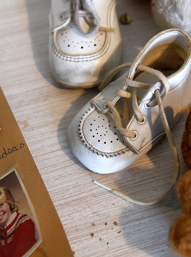 Cheri Lindsey's baby shoes and photos of school friends. David and Jean Lindsey have kept Cheri's bedroom the same as it was before she was murdered in 1984.