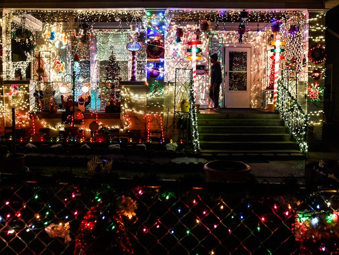 Wrapped in lights the house at 803 Jefferson Avenue