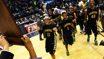 Carver takes the court to claim their 6A state championship trophy at the AHSAA State Finals in Legacy Arena at the BJCC in Birmingham, Ala. on Saturday February 28, 2015.