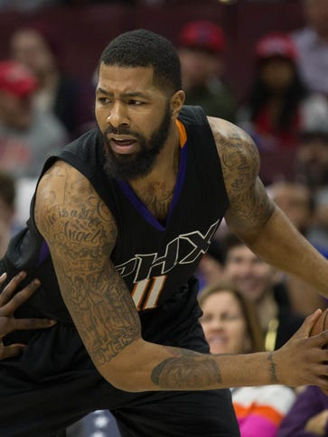Suns forward Markieff Morris (11) looks for an opening