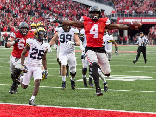Nov. 26: Ohio State defeated Michigan, 30-27 (OT).