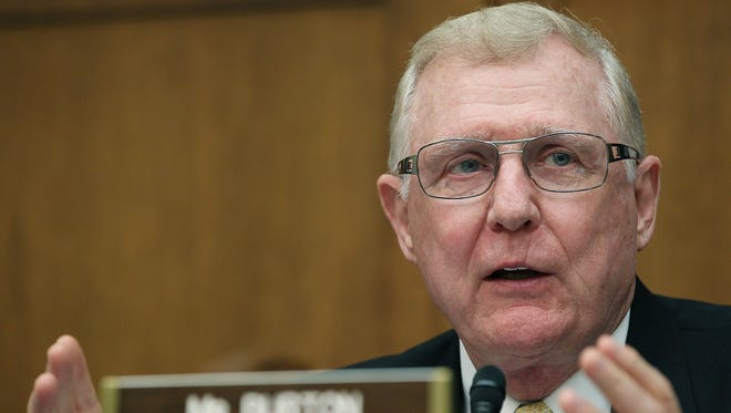 """Former Rep. Dan Burton (shown here at a 2011 committee hearing), who retired from Congress in 2013, was paid to """"maintain or increase protection for the public with reference to psychiatric treatments including drugs and brain devices,"""" in a bill Congress is considering to speed the development of drugs."""