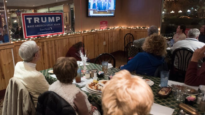 Members of the local Republican Party gather at Franco's Italian Restaurant in downtown Pensacola to watch the first State of the Union address by President Donald Trump on Tuesday, Jan. 30, 2018.