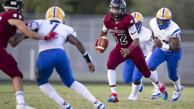 In this 2019 photo, Palm Beach Central Broncos quarterback Anarjahe Douriet (12) runs against Miami Northwestern. Miami Northwestern was one of five Miami-Dade public schools to opt into the state postseason series. The rest joined Palm Beach Central, and all other Palm Beach County public schools, in opting out of the FHSAA football playoffs. Broward public schools also opted out.