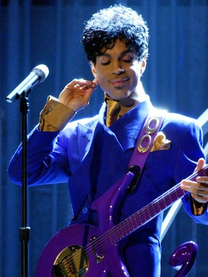 "Prince performs ""Purple Rain"" as the opening act during the 46th Annual Grammy Awards show on Feb. 8, 2004, at the Staples Center in Los Angeles. Prince died on April 21, 2016. He was 57."