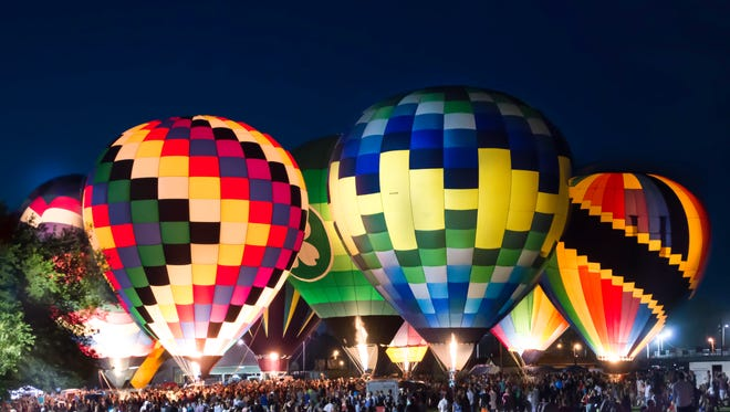 The balloons at the Hot Air Balloon Glow do not take flight and people cannot ride them, but it's a gorgeous sight to behold.