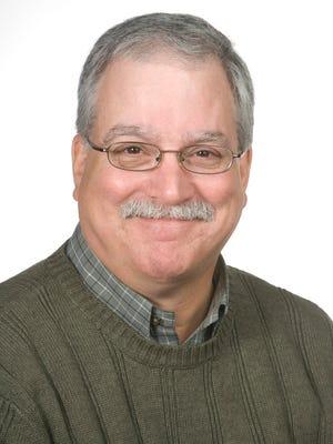 Dr. David K. Mills