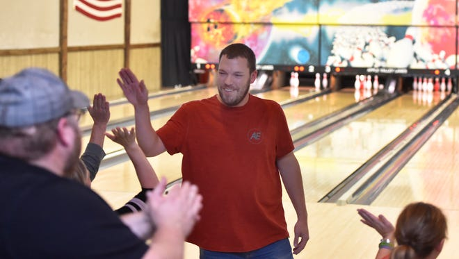 Dan LaLuzerne of Sturgeon Bay records a strike during the Adam LaLuzerne Memorial Bowling Event on Sunday at Apple Valley Lanes in Sturgeon Bay. The 65 bowlers raised $12,031 for the Adam LaLuzerne Humanitarian Scholarship. Dan is Adam's first cousin.