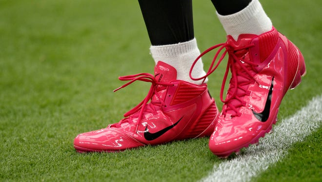 Arizona Cardinals wide receiver Larry Fitzgerald wears pink shoes to highlight breast cancer awareness month prior to an NFL football game against the New York Giants, Sunday, Oct. 2, 2011, in Glendale, Ariz.