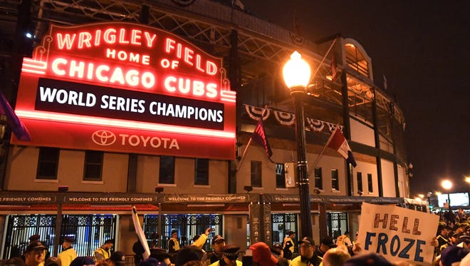 Chicago Cubs fans celebrate after Game 7 of the 2016 World Series against the Cleveland Indians outside of Wrigley Field.