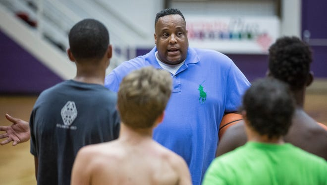 Chandler Thompson works with Central's basketball team June 27 at the Muncie Fieldhouse.