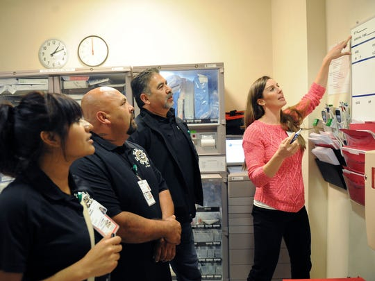 From left, CHOICE team members Alma Cervantes, Juvenal Farias, Brian Contreras and Kristen Spencer go over emergency room protocol on Monday in Salinas. CHOICE is a program of Natividad Trauma Center which promotes positive alternatives to retaliation and re-injury among youth and young adults injured by violence.