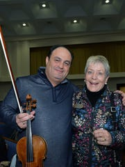 Spotlight performer Leonid Sigal, left, with Jean Beckert, president of the Vero Friends of the ACO, during rehearsal at Community Church of Vero Beach.