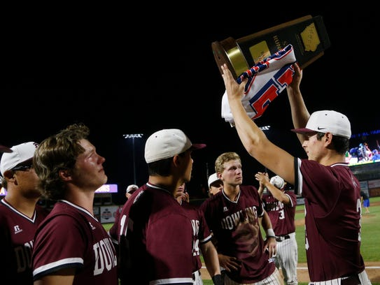 Dowling raise up their state runner up trophy Saturday,