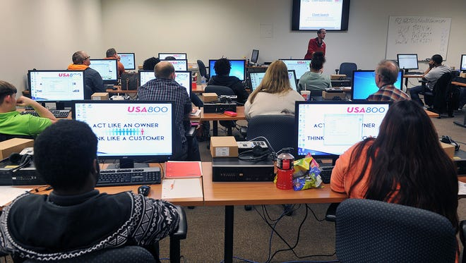 New agents attend a training session at the USA800 call center in Wichita Falls. The business has added 450 employees since it opened in October 2016.