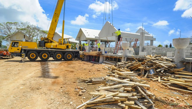 Contract workers continue on the construction of over 20 concrete huts in Hagåtña on March 14, in preparation of the 2016 Festival of Pacific Arts event.