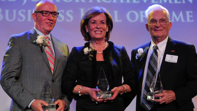 From left Eddie Mannis, Eleanor Yoakum and Will J. Pugh pose for a photo after being inducted into Junior Achievement's East Tennessee Business Hall of Fame at the Marriott Thursday, April 6, 2017.