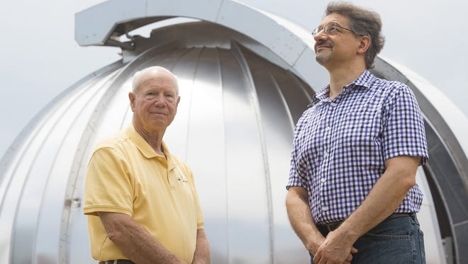 Karl Zeller, left, and Ned Nikolov are pictured outside the Sunlight Peak Observatory. The scientists have developed a mathematical model that predicts average planetary surface temperatures that calls into question current theories on global warming.