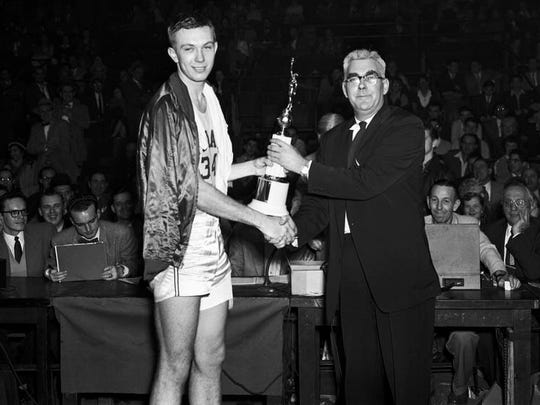 IU coach Branch McCracken awarding Don Schlundt the