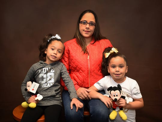 Marie Olivero poses with two of her daughters, Adrielys Rodriguez, 6, and Nairielys Rodriguez, 5.