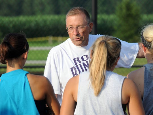 Road Runers Elite coach Rick Sherman talks to members of his team during a 2014 practice at River View High School. Sherman retired after 50 years in coaching recently, marking the end of the Road Runners program, which had existed since 1989.