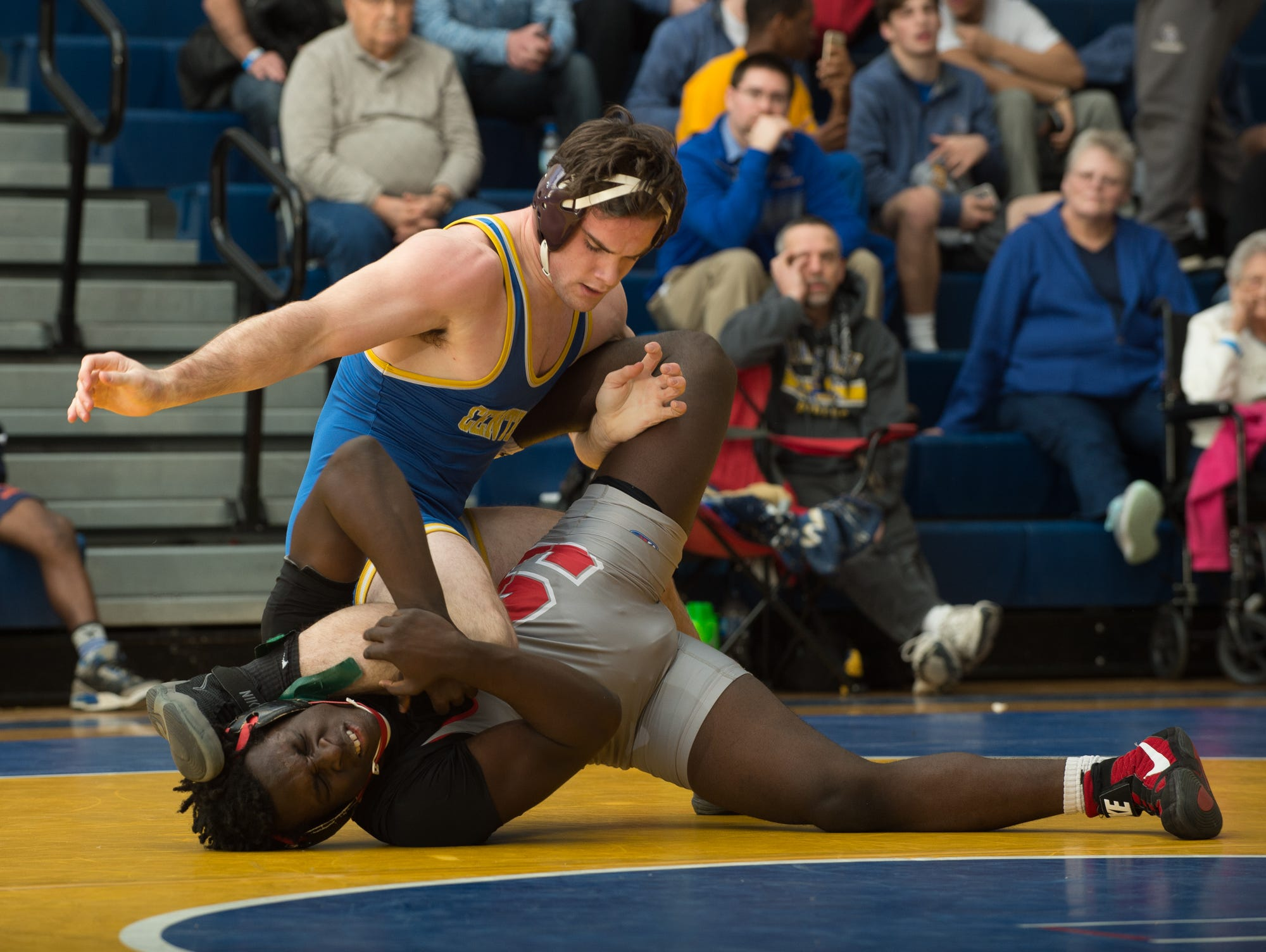 Sussex Central's Blake Chambers brings Smyrna's Larsen Wilson down to the mat in the 170 pound championship match at the Henlopen Conference wrestling tournament at Sussex Central High School.
