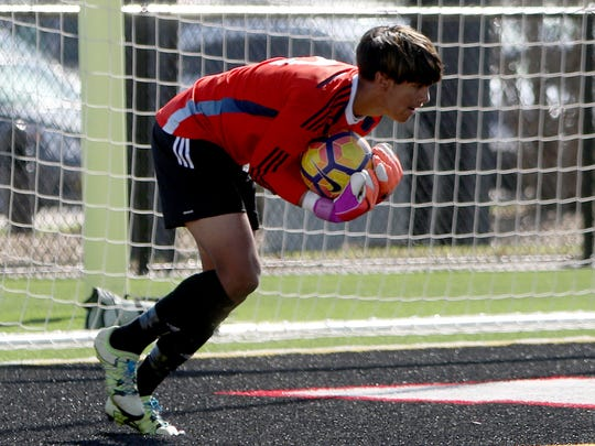 Wichita Falls High School's Israel Gonzalez makes the final save of the match against Aledo Tuesday, April  4, 2017, in the Region I-5A Regional Quarterfinal in Mineral Wells. The Coyotes defeated the Bearcats 1-0. The Coyotes defeated the Bearcats 1-0.