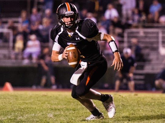 Palmyra's Grant Haus looks for running room as Palmyra defeated Camp Hill 24-21 in the final seconds of their season opener on Friday, August 25, 2017.