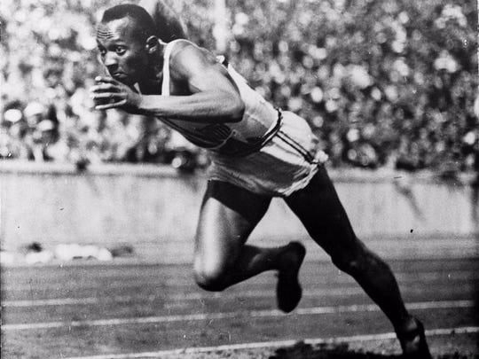 Jesse Owens starts a heat of the 200-meter dash at the 1936 Summer Olympics in Berlin. Owens went on to win four gold medals and break or tie Olympic records nine times.