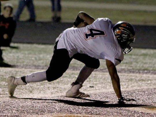 Nocona's Francisco Gracia stays on his feet for the