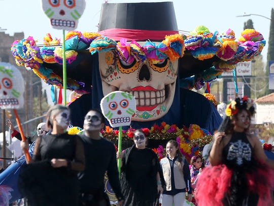 Dia de los Muertos, a float from the Downtown Lions Club, rolls down Montana Ave. on Thursday.