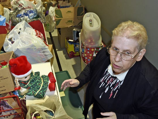 In this 2016 file photo, Lynne Newman prepares to organize items for the annual Salvation Army Christmas dinner.