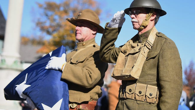 WWI Centennial in Rutherford on Saturday November 11, 2017. (From left) Eugene Hough from Saving Hallowed Ground and Barry Johnson with the folded American flag.